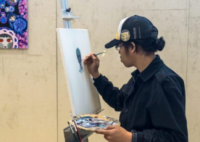 Student painting at Easel — Art Program at Skagit Valley College, 2017