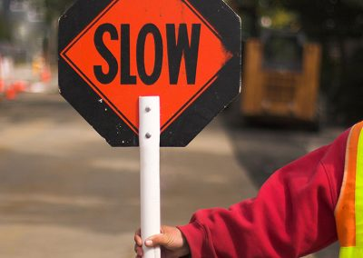 Photo of Flagger with a slow sign for Flagging class in the Community Education Program at Skagit Valley College, 2017