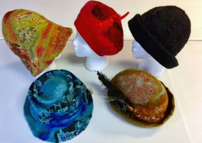 Textural Felted Hats made in a class of the Community Education Program at Skagit Valley College, 2017