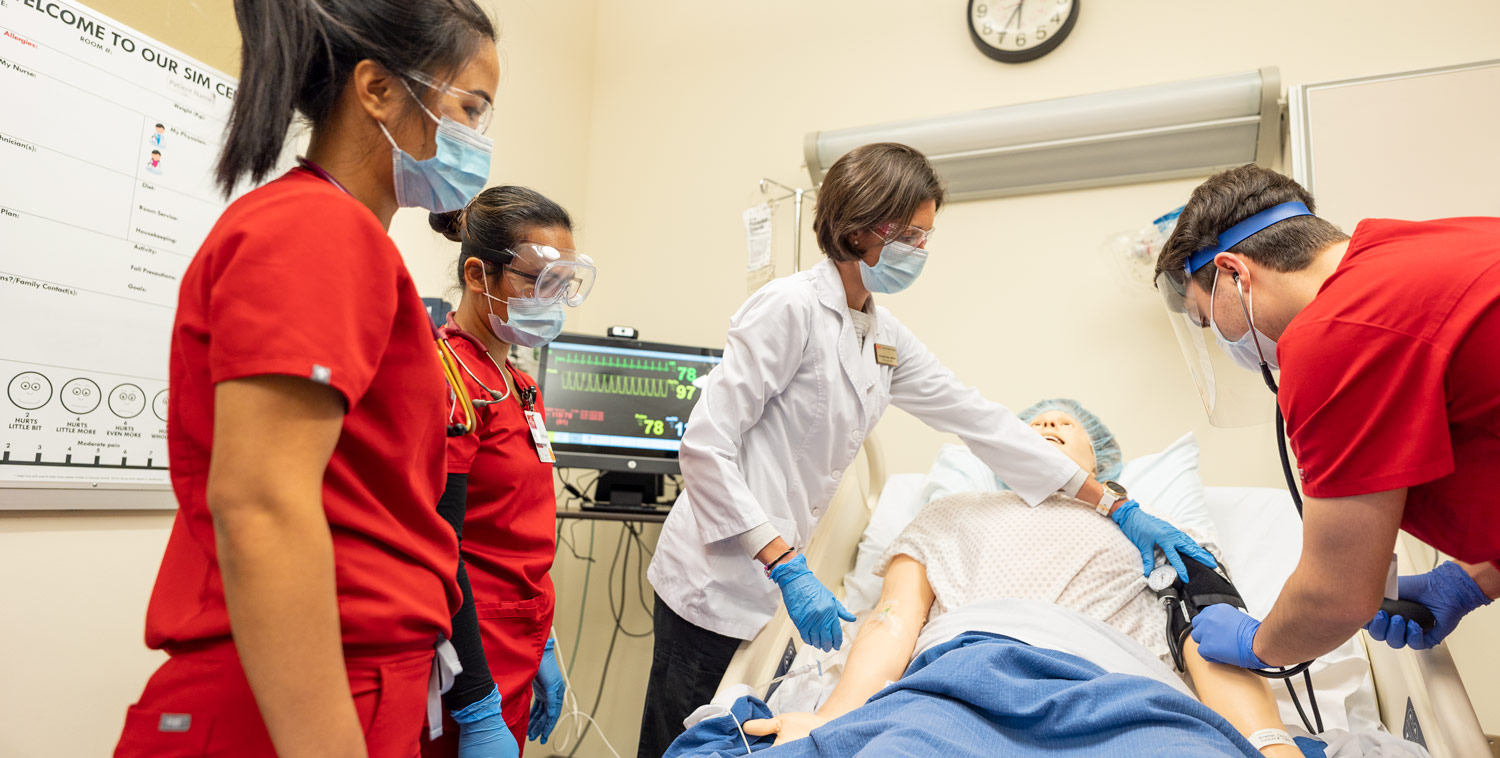 Nursing students working with the simulation model